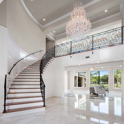 elegant foyer stairs designed by Element Home Builders, a Central Florida residential builder